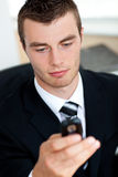 Concentrated young businessman sending a text Royalty Free Stock Photo