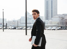 Concentrated young businessman walking outdoors Stock Photography