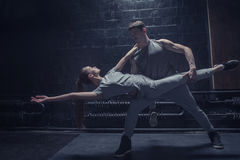 Concentrated young dancers performing together Stock Photo