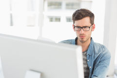 Concentrated young male artist using computer Stock Photos