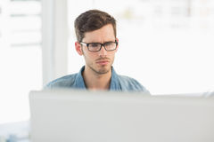 Concentrated young male artist using computer Royalty Free Stock Photo