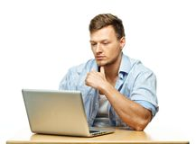 Concentrated young man behind laptop Stock Images