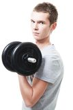 Concentrated young man lift weights Stock Photography