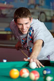 Concentrated young man playing snooker Royalty Free Stock Photography