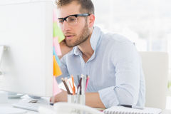 Concentrated young man using computer Royalty Free Stock Image