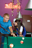 Concentrated young people playing snooker. Photo of young people during snooker game royalty free stock images
