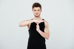 Concentrated young sportsman gesturing with hands. Royalty Free Stock Photo