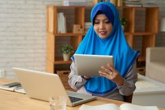Muslim woman with gadgets stock image