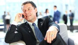 Concentrating businessman on call Stock Image