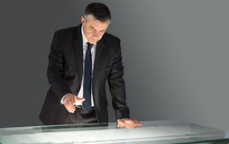 Concentrating businessman leaning on desk Royalty Free Stock Images