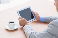 Concentrating businessman using a tablet Royalty Free Stock Images