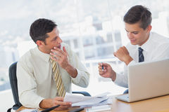 Concentrating businessmen working together Stock Photos