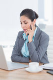 Concentrating businesswoman using her computer Stock Photography