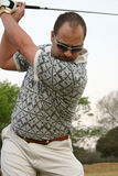 Concentrating golfer Royalty Free Stock Photos