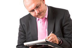 Concentrating on his notes Stock Images
