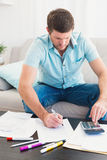 Concentrating man counting his bills Royalty Free Stock Image