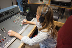 Concentrating pretty radio host moderating Royalty Free Stock Photos