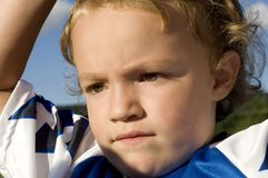 Concentrating Soccer Player. Young, soccer player with concentrating look on face stock photography