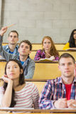 Concentrating students sitting at lecture hall Stock Photography