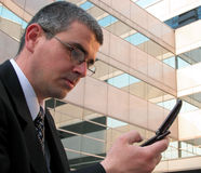 Concentration. Businessman checking the news on his mobile phone in a city Royalty Free Stock Photo