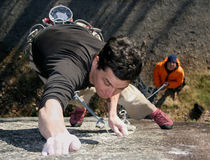 Concentration. A rock climber struggles to hold on stock image
