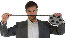 Businessman with the film reel Royalty Free Stock Photos
