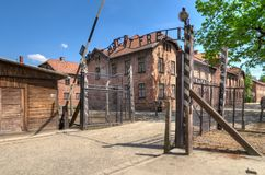 Concentration camp Auschwitz-Birkenau in Oswiecim, Poland. OSWIECIM, POLAND - MAY 12, 2016: Gate entrance to concentration camp Auschwitz with a sign Arbeit Royalty Free Stock Photography