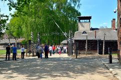 Concentration camp Auschwitz-Birkenau in Oswiecim, Poland. OSWIECIM, POLAND - MAY 12, 2016: Gate entrance to concentration camp Auschwitz with a sign Arbeit Royalty Free Stock Photos