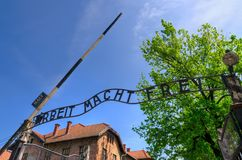 Concentration camp Auschwitz-Birkenau in Oswiecim, Poland. OSWIECIM, POLAND - MAY 12, 2016: Gate entrance to concentration camp Auschwitz with a sign Arbeit Stock Photography