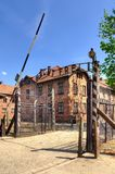 Concentration camp Auschwitz-Birkenau in Oswiecim, Poland. OSWIECIM, POLAND - MAY 12, 2016: Gate entrance to concentration camp Auschwitz with a sign Arbeit Stock Image
