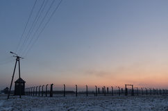 Concentration camp Oswiecim / Auschwitz,Poland. Winter scenerey with a dramatic sky at sunset of the birkenau concentration camp royalty free stock image