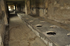 Concentration camp toilets Stock Photos