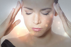 Concentration. Woman thinking, holding her forehead Royalty Free Stock Image