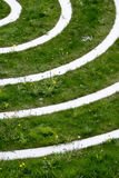 Concentric circles. With dandelions and weeds overgrowing the terrain Royalty Free Stock Photo