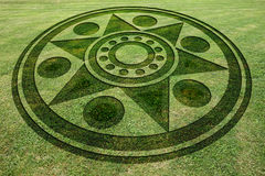 Concentric circles star fake crop circle in the meadow Stock Images