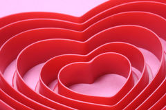 Concentric Hearts. On pink background Royalty Free Stock Images