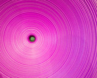 Concentric purple circles, plastic texture Royalty Free Stock Photo