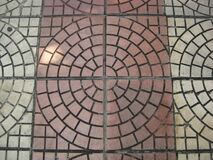 concentric-reddish-and-grey-pavement Royalty Free Stock Images