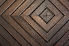 Concentric squares carved in wooden boards. Detail of door with concentric squares carved in wooden boards stock photo