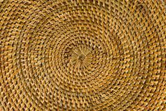 Concentric texture of a natural woven surface of brown color stock photo