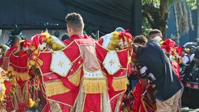 Panorama of people in colorful costumes prepare for dominican annual carnival