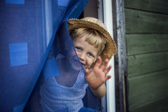 "Concept ""Bye, Summer!"". Outdoor portrait:  beautiful kid smiling and waving Royalty Free Stock Photography"