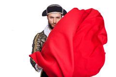 "Concept ""Passion"". Toreador with a red cape.  Isolated on a white background Royalty Free Stock Image"