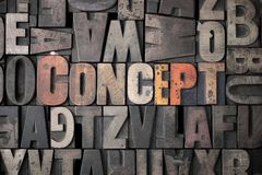 CONCEPT. The word 'Concept' spelled out in very old letterpress blocks Royalty Free Stock Photos