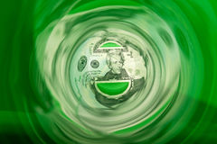 Money Down the Drain. Concept  - abstract photo of money in a swirling  a green tube or tunnel Royalty Free Stock Image