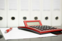 Concept of accountant desk with calculator,pen,document Royalty Free Stock Photos
