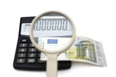 Concept of accounting fraud with money,calculator,magnifier Stock Photo