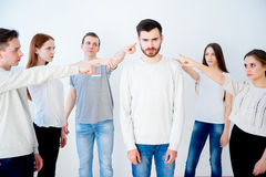 Concept of accusation. Group of people pointing at a man Royalty Free Stock Photos
