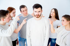 Concept of accusation. Group of people pointing at a man Stock Images