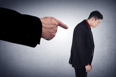 Concept of accused businessman with with fingers pointing Stock Images